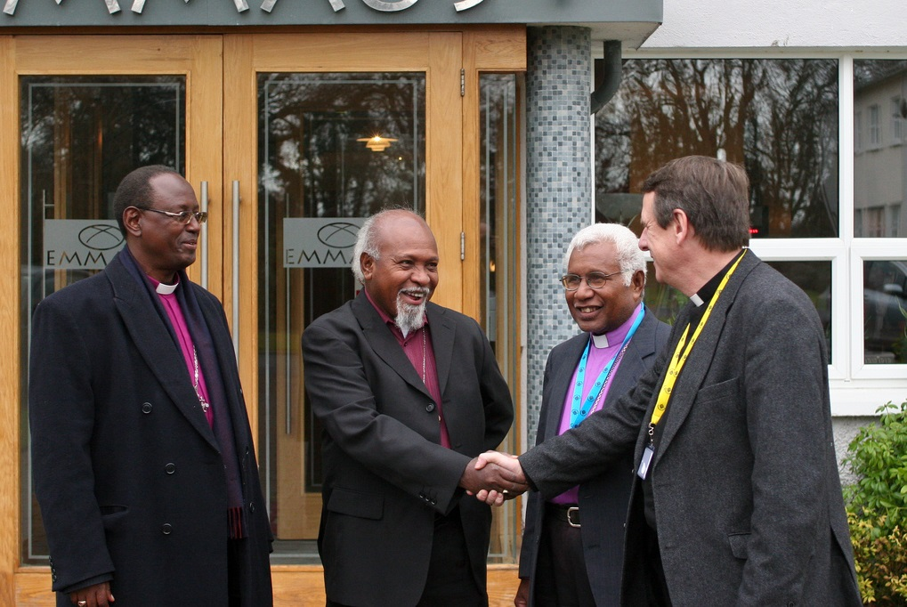 (L to R) Burundi Archbishop Bernard Ntahoturi, Papua New Guinea Archbishop Archbishop Joseph Kopapa, Melanesia's Archbishop David Vunagi is greeted by Secretary General of the Anglican Communion Kenneth Kearon